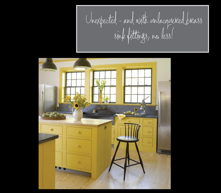 yellow-kitchen-cabinets-with-soapstone-counter-tops-and-brass-fittings