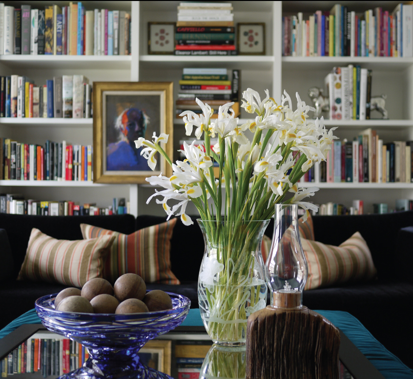 Iris-Flower-Arrangement-in-an-Etched-Tiffany-Vase-Ticking-Stripe-Pillows-Book-Cases