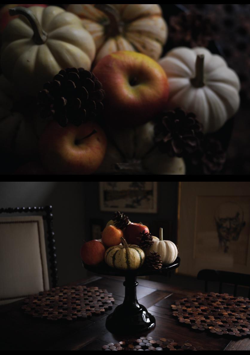 mini-pumpkin-arrangement-with-pinecones-on-a-black-cakeplate