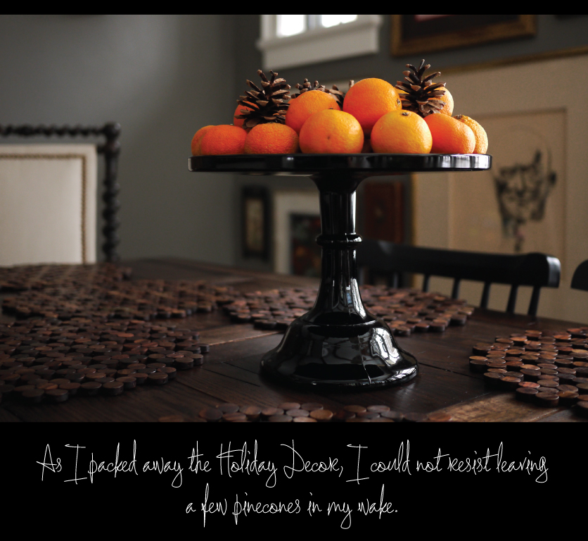 Clementines-and-Pinecones-on-a-Cake-Pedestal